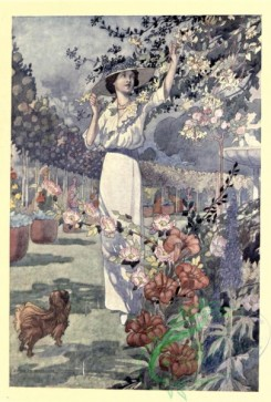 gardens-00036 - Woman in wide hat with a dog in the garden touching flowers [1661x2459]